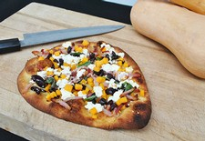 Butternut Squash Flatbread With Bacon, Black Olive, and Goat Cheese